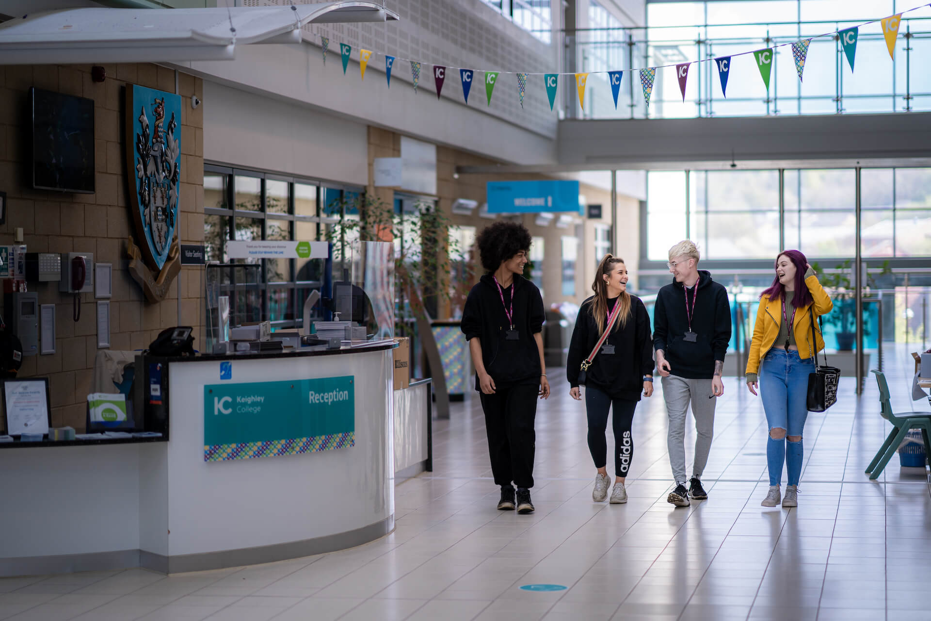 Students walking through Keighley College main entrance